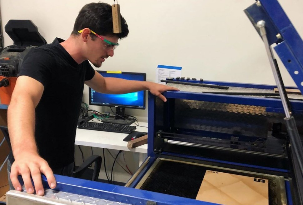 A Hacker Lab member prepping a workpiece on the lasercutter